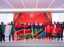 Jubilant students from Nigeria, Kenya, Tanzania and Angola fly their respective countries' flags following victory in technology awards