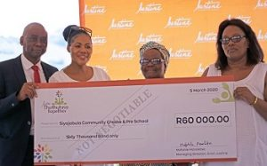 Seen here handing over the R600, 0000 cheque is Avon Justine Managing Director for Turkey, Middle East and Africa, Mr Mafahle Mareletse. Next to Mr Mareletse is Avon Justine Communications & Corporate Affairs Director, Ms Bridget Bhengu and beneficiaries of the money donated.