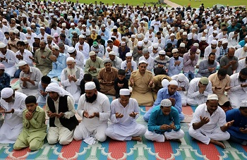 Muslims worshipping Allah. Photo by EPA-EFE